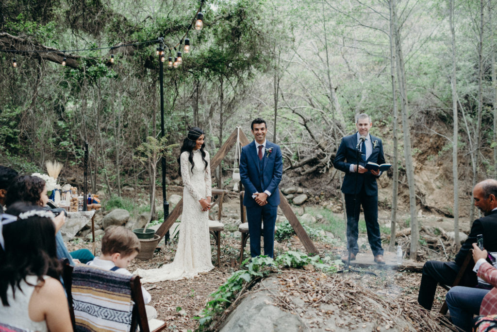boho wooden Triangle Arch for ceremony in woods